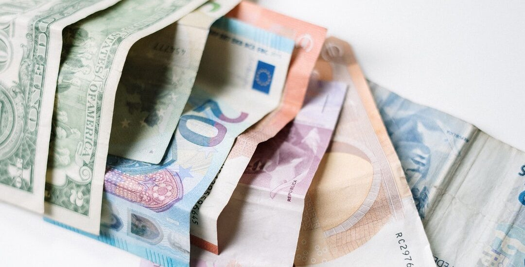 picture of dollars and euros to represent cost cutting ideas for large businesses