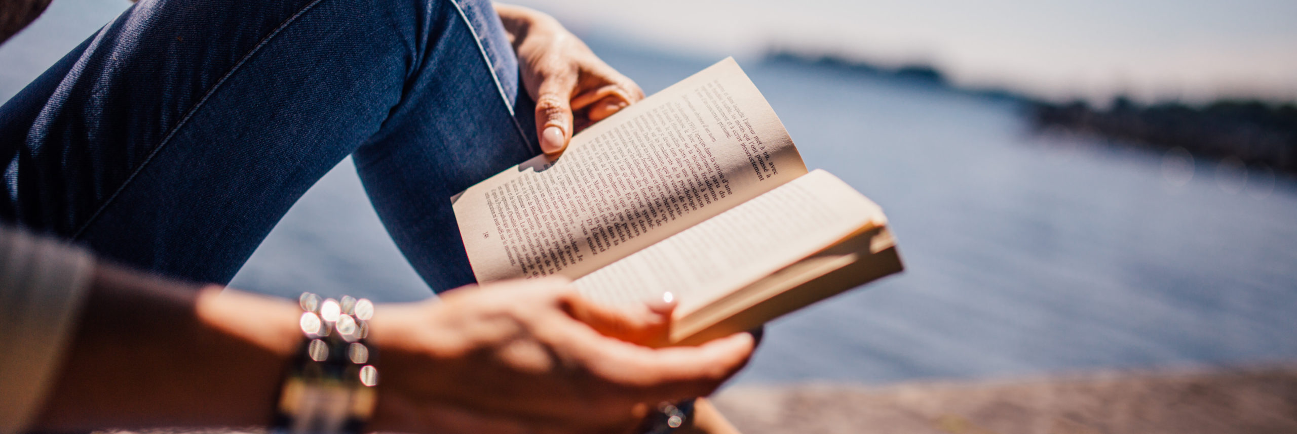 be a better writer when you read more person reading book